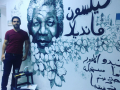 Mohammed Motiah and portrait of Nelson Mandela