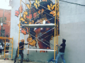 Installing the No Borders Mural